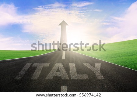 Empty road with word of Italy and arrow upward at the end of a road