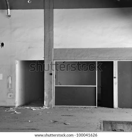 Empty room and concrete wall ���©n derelict factory interior. Black and white. - stock photo
