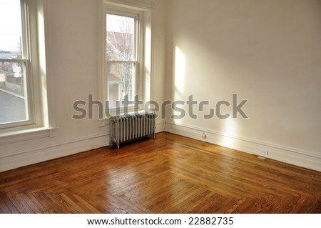 empty room in an old house with hardwood floor - stock photo