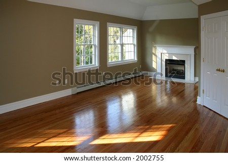 Empty room in new home with fireplace .. ambient window light - stock photo