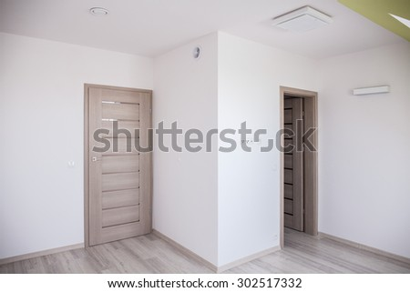 Empty room in the attic in modern commodious house - stock photo