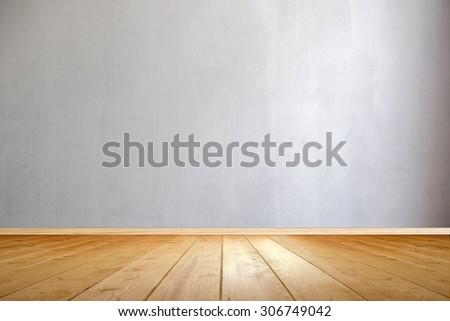 Empty room interior, wooden floor and concrete wall - stock photo