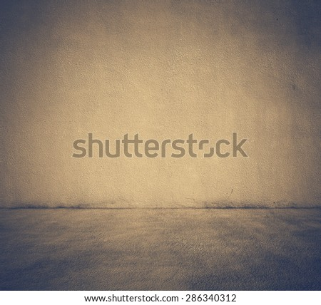 empty room with concrete wall, retro filtered, instagram style - stock photo