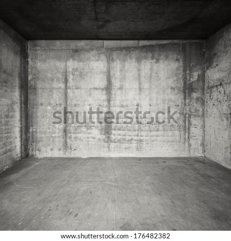 Empty room with concrete walls and floor. - stock photo
