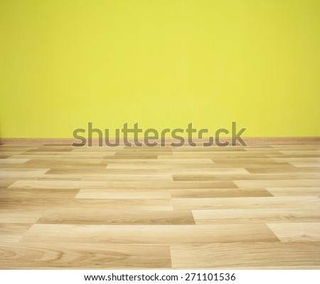 Empty room with green wall and wooden floor - stock photo