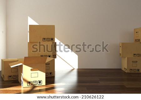 empty room with moving boxes - stock photo