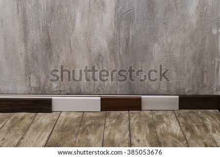 Empty room with old wood floor and rough plaster walls.   - stock photo