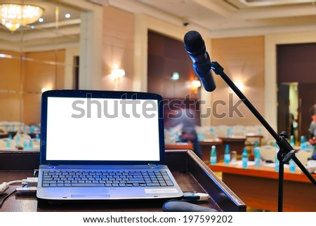 empty rostrum and notebook with blank screen  - stock photo