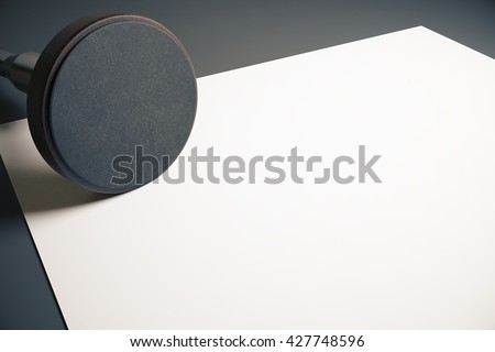 Empty round stamper and blank paper sheet on dark desktop. Mock up, 3D Rendering - stock photo