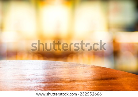 Empty round table top at coffee shop blurred background with bokeh light,Template mock up for display of your product. - stock photo