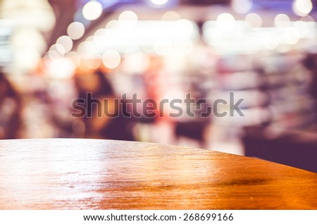 Empty round table top at coffee shop blurred background with bokeh light,Template mock up for display of your product.. - stock photo