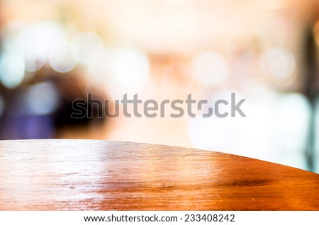 Empty round table top at store blurred background with bokeh light,Template mock up for display of your product. - stock photo
