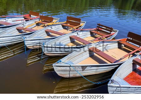 Empty row boats at a lake viewed from above - stock photo