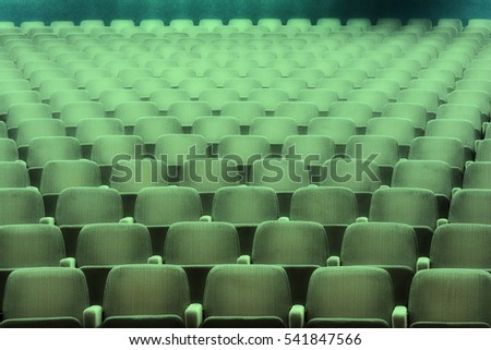 Empty rows of theater or movie seats.