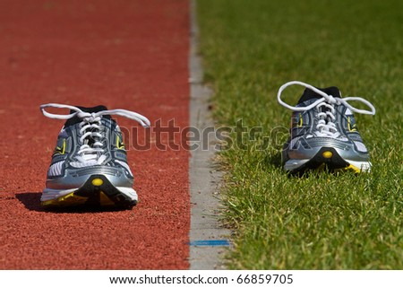 Empty runners on racetrack and green - stock photo