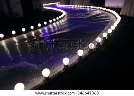 Empty Runway Fashion Show With Ball Glowing Lighting Along Walk Way Plastic White Floor In