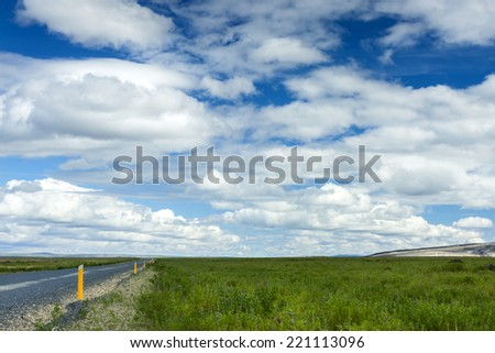 Empty rural lonely country road in South Iceland/Icelandic Road - stock photo