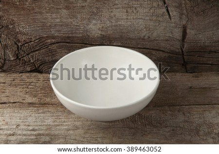 empty rustic ceramic dessert plate on wooden background closeup