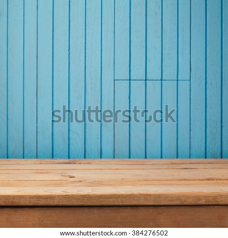 Empty rustic table over blue wooden wall background - stock photo