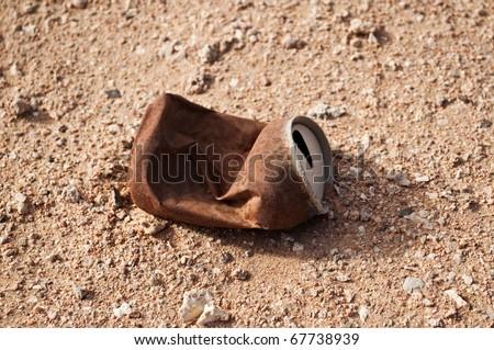 Empty rusty steel jar in the desert - stock photo