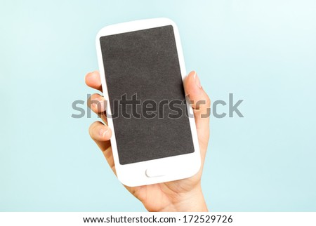 Empty screen phone concept on blue background - stock photo