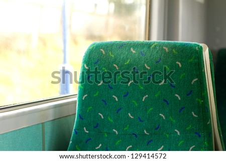 empty seat by the window on a train carriage - stock photo