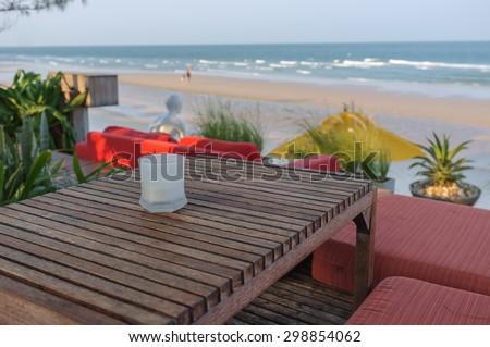 empty seat with dining table by the beach
