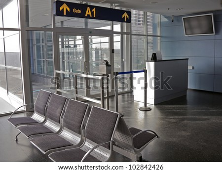 Empty seating at boarding gate at an airport - stock photo