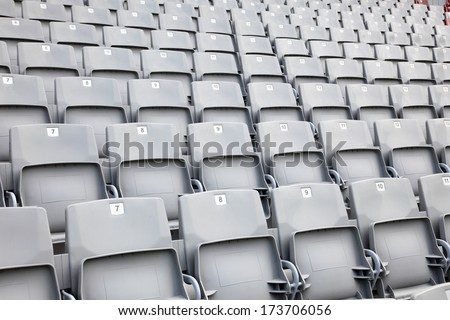Empty seats in a sports stadium - stock photo