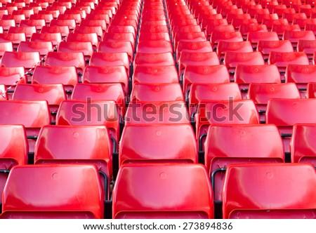 Empty seats red at stadium. - stock photo