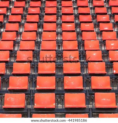 empty seats red plastic in a stadium. - stock photo
