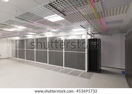 Empty server room of the modern data center. - stock photo