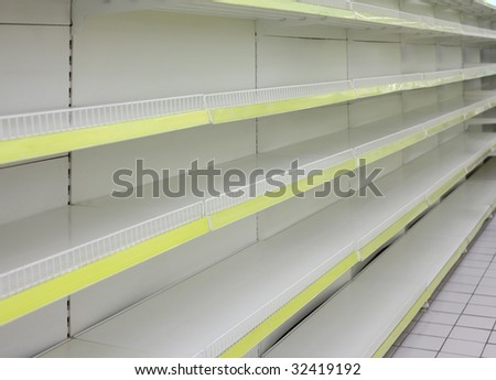 Empty shelves in  shop - stock photo