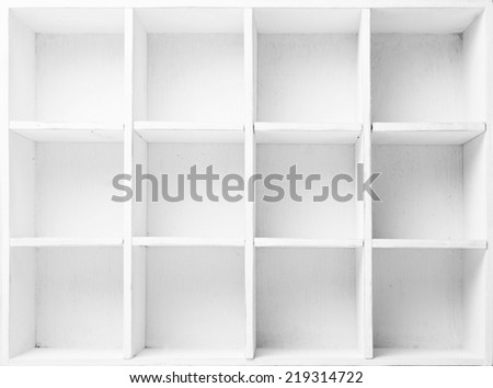 Empty Shelves in the white wooden rack - stock photo
