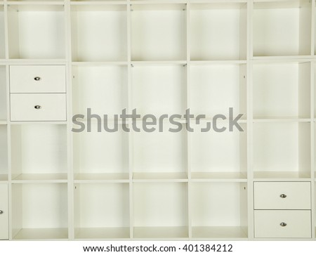 Empty shelves in white wooden rack, close up - stock photo