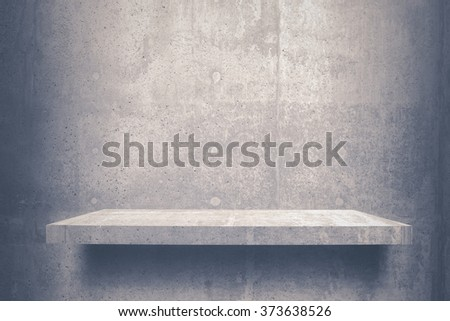 empty shelves top Ready for product display montage; cement shelves and gray cement background.. - stock photo