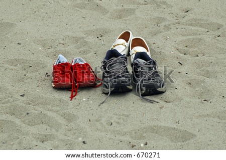 Empty Shoes on Beach - stock photo