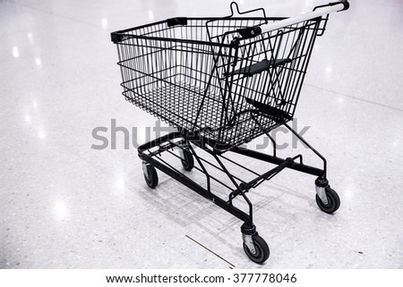 Empty shopping cart- trolley in the supermarket - stock photo