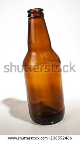 Empty short microbrew beer bottle. - stock photo