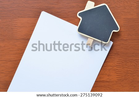 Empty sign clip over the white blank paper - stock photo