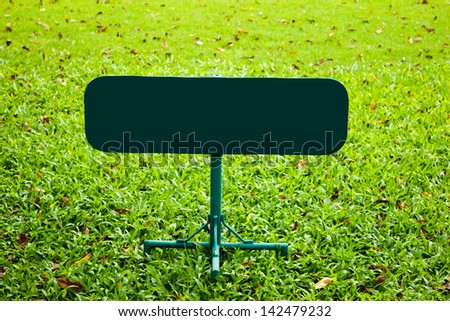 empty sign over green lawn
