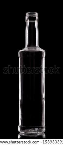Empty single bottle with nice design on black. - stock photo