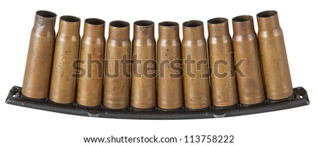 empty SKS-45 carbine bullet shells in holder over white background - stock photo