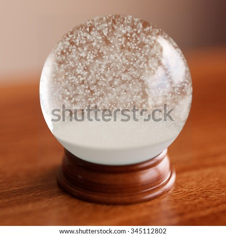 Empty snow globe on wooden table