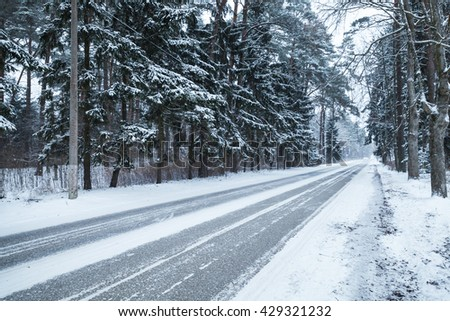 Empty snowy rural road photo background, cold winter season - stock photo