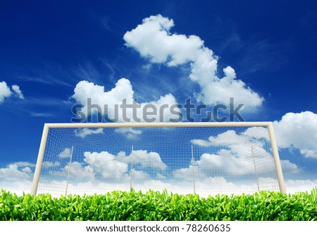 Empty Soccer Goal and a Beautiful Blue Sky. Plenty of room for your ad copy. - stock photo