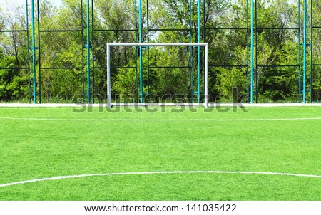 Empty soccer goal on a sunny day - stock photo
