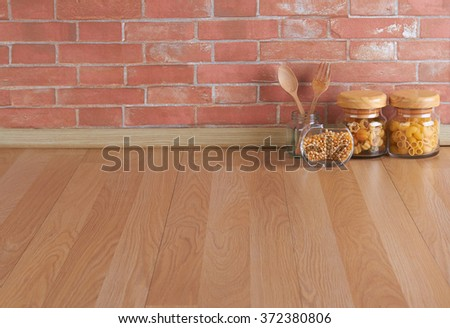 Empty space on the kitchen counter and brick wall - stock photo