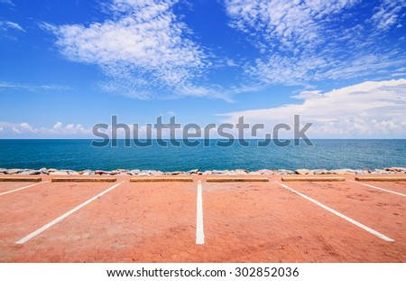 Empty space parking lot on the sea coast. - stock photo