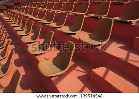 Empty  sport stadium seats - stock photo